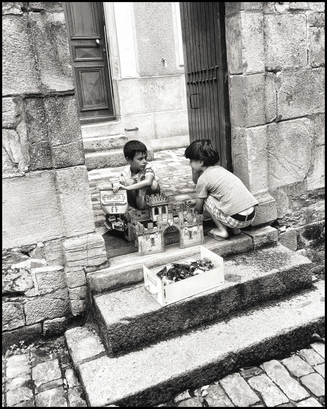 boys playing medieval fort and knights Vitré Brittany