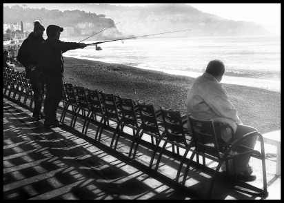 fishermen on the promenade des anglais nice france march 4 2019